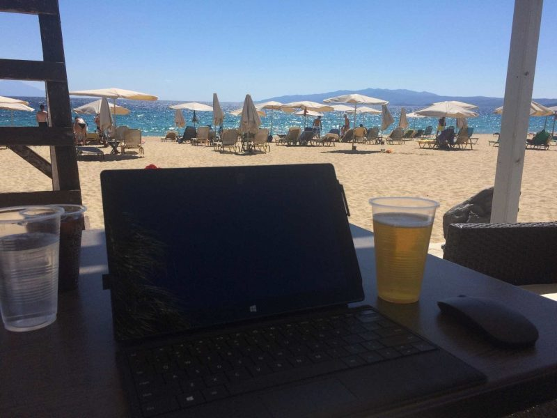 Laptop and drink by the beach Assa Maris