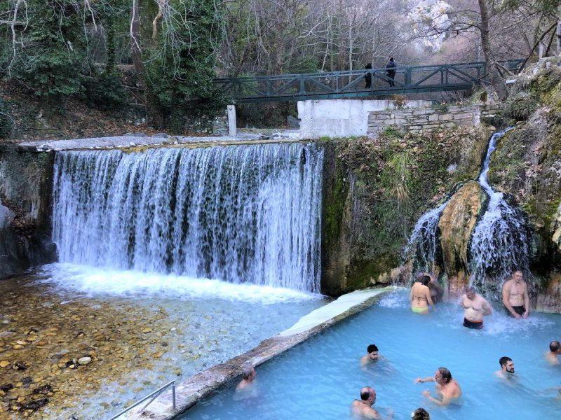 People in waterfall pool in Pozar, Greece.
