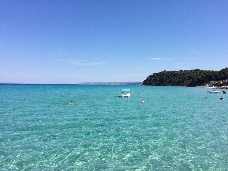 People swimming in the Aegean Sea in Greece.
