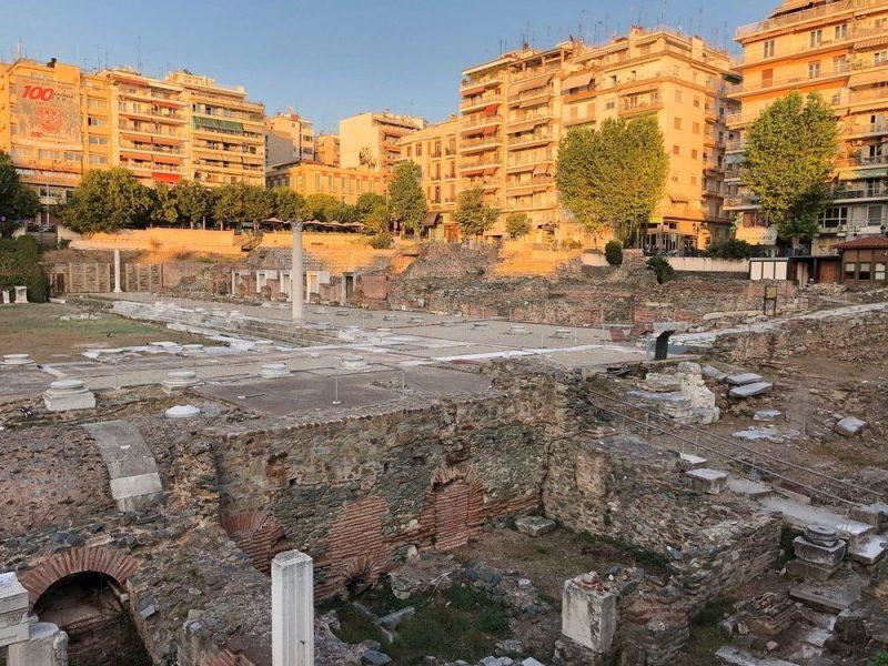 Roman ruins around city buildings.