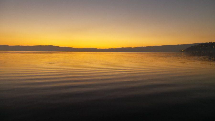 Watching the sunset over Lake Ohrid. Beautiful sunset photos. Amazing sunset photos.