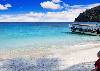 Bucket List Ideas: 5 Things To Do in Asia - Buddhist sitting on beach in Malaysia meditating in front of the ocean.