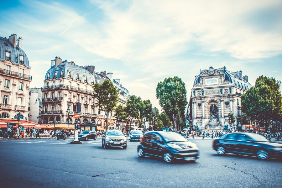 A car driving on a city street in Paris, France.