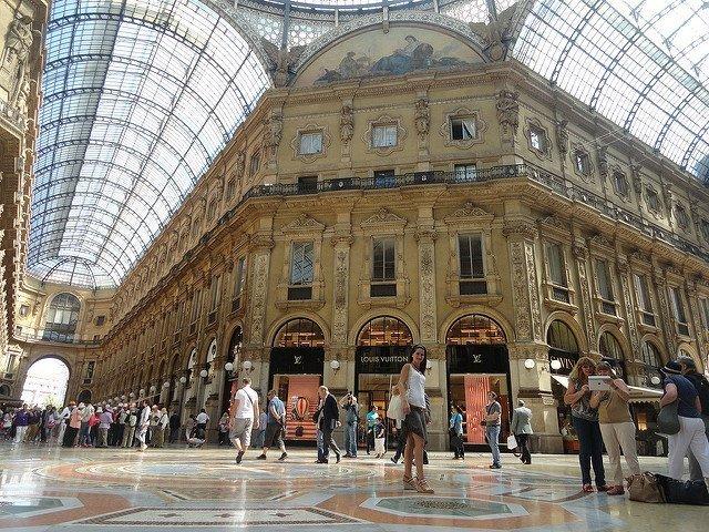 People exploring the Louis Vuitton in Galeria V. Emanuele, Milan, Italy.