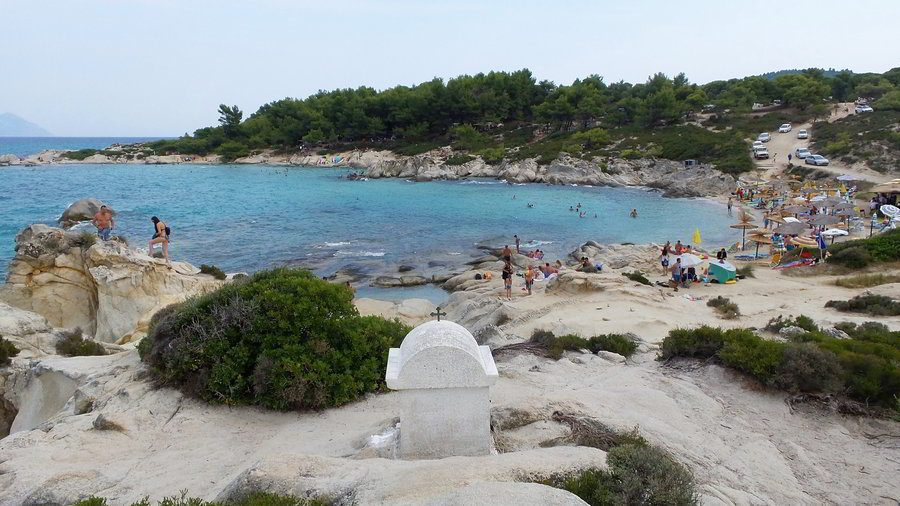 The exotic Portokali Beach in Sithonia, Chalkidiki, Greece that attracts the young crowd and adventurers due to its hidden location and natural untouched rocky nature.
