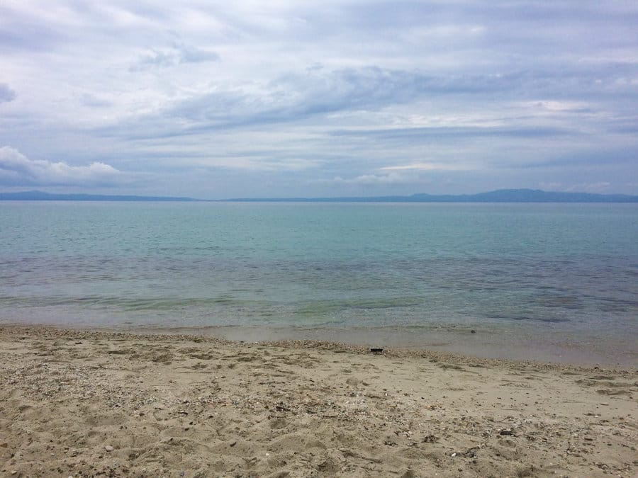 Pallini beach in Kassandra, Chalkidiki, Greece has one of the most pristine beaches and emerald-clear waters.
