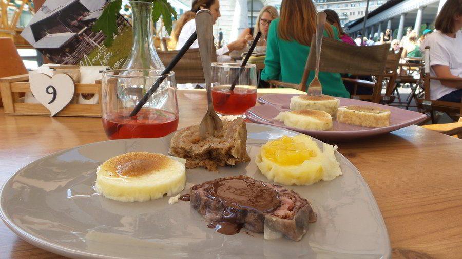 Slovenian cuisine - struklji - with homemade ice tea in Ljubljana.