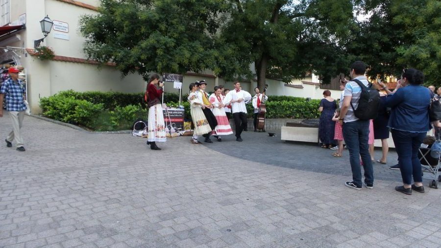 People daincing traditional folklore dances with bystanders cheering on in Zagreb.