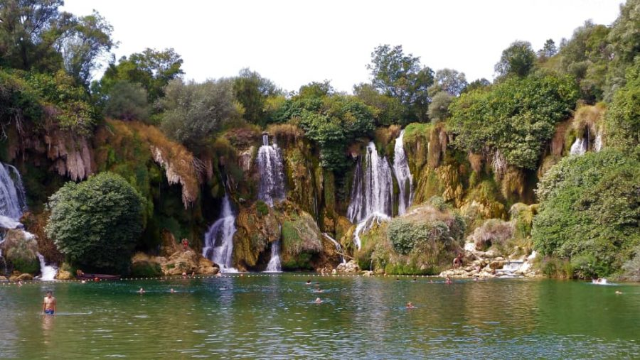 People swimming at the Kravica waterfalls in Bosnia and Herzegovina.