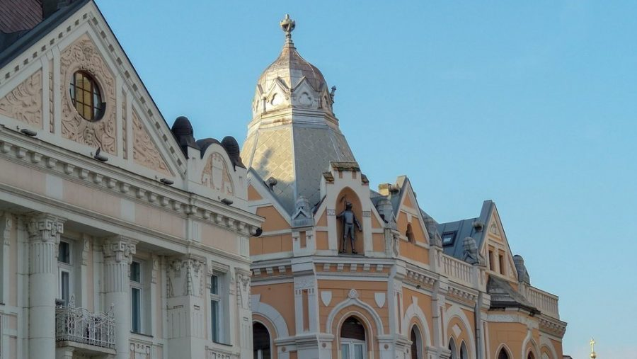 Iron man or knight statue on top of an old building with Austro-Hungarian architecture in Novi Sad.