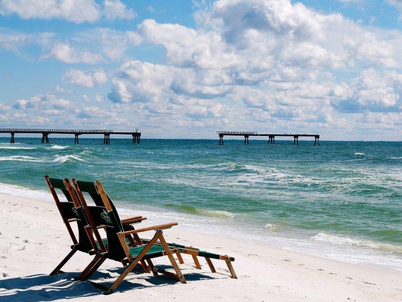 Beach chairs on beach in Destin, Florida.