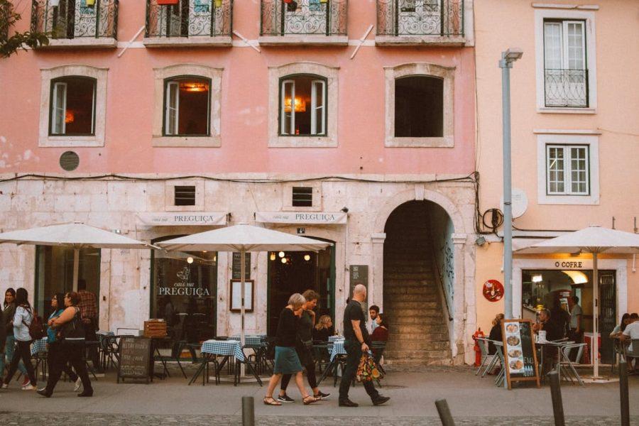 People walking on a street in Lison, Portugal.