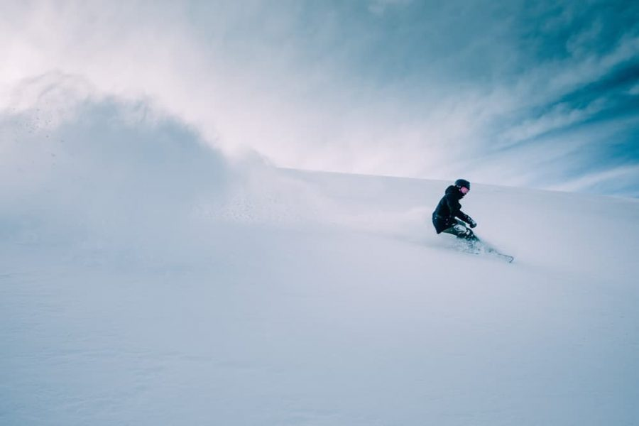 A person snowboarding on snow.