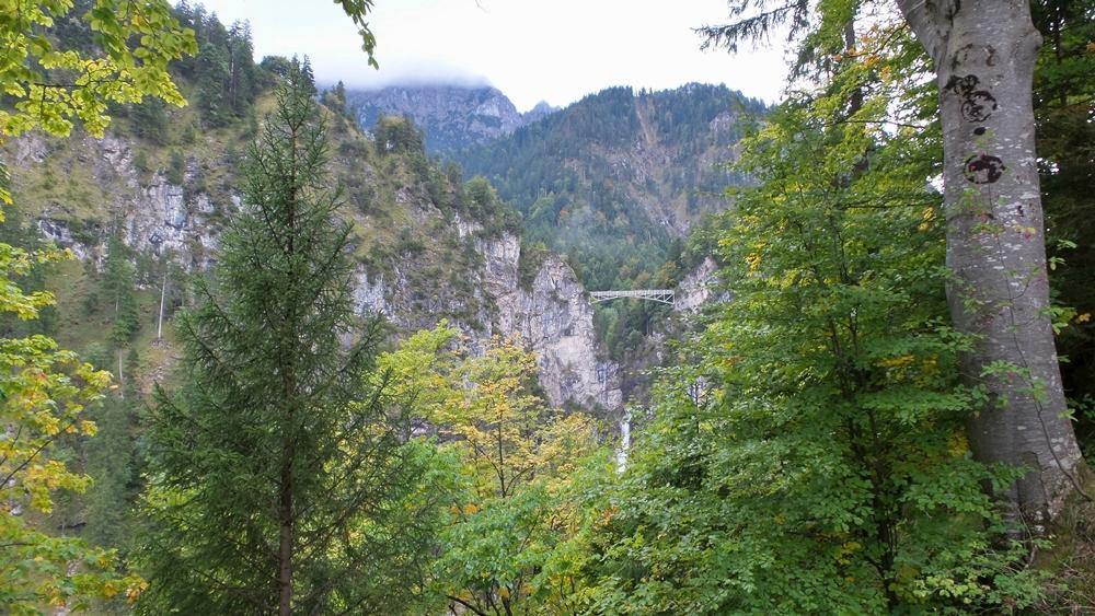 A metal bridge between two mountain hills