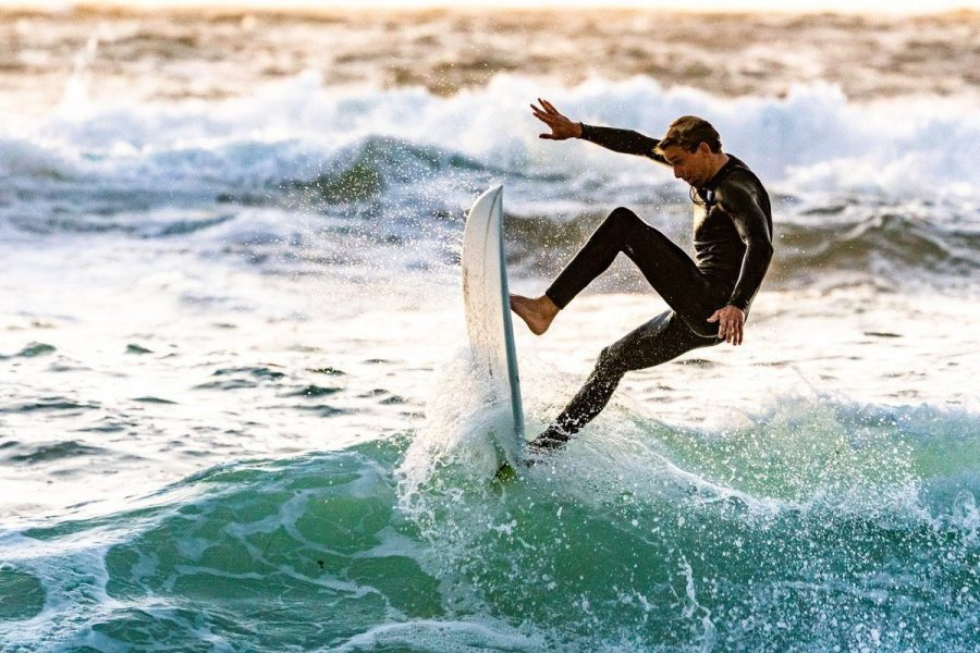 Male surfer riding a wave in the water.