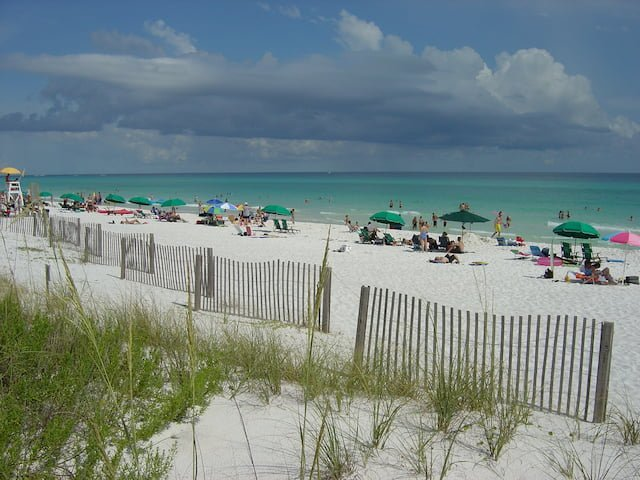 People on a beach in Florida sun bathing.