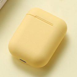 Yellow wireless bluetooth headphones for travelers