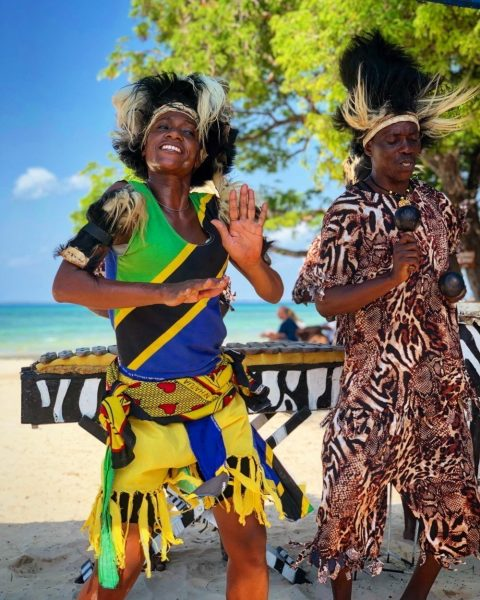 Woman and a man doing a traditional dance in Zanzibar, Tanzania.