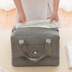 Woman placing shirts in a grey travel handbag