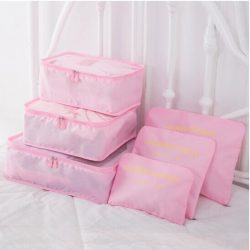 Pink travel bag system for luggage clothing organizer.