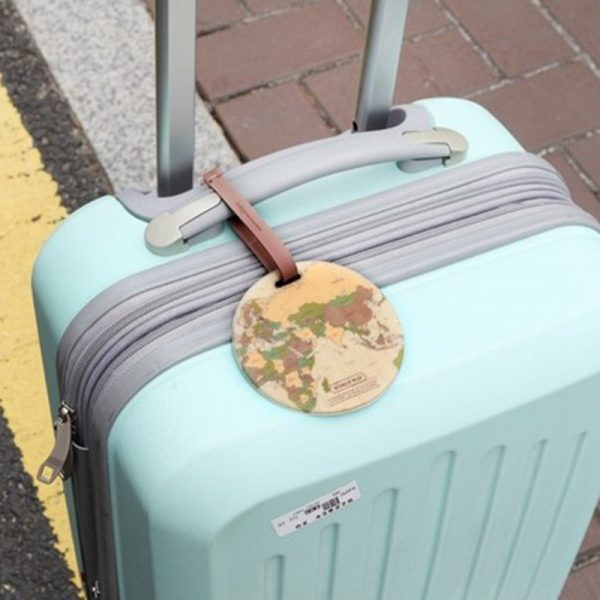 Vintage travel tag on mint green luggage