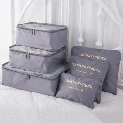 Grey travel bag system for luggage clothing organizer.