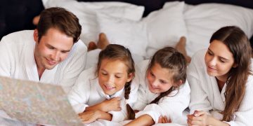 Family preparing for a one-week family vacation in hotel room.