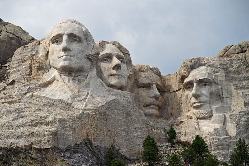 American president faces carved into a rocky mountain.