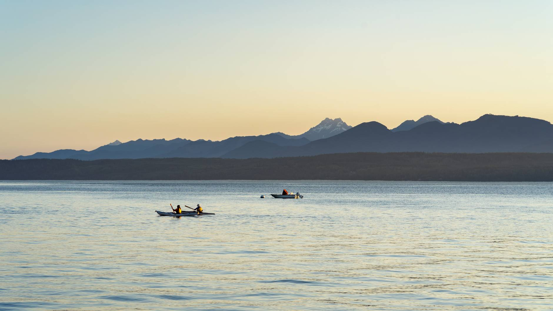 two men in kayaks out at sea