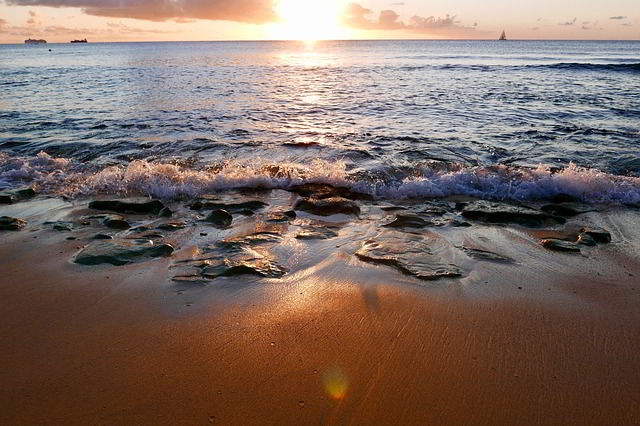 Sunset over water and beach.