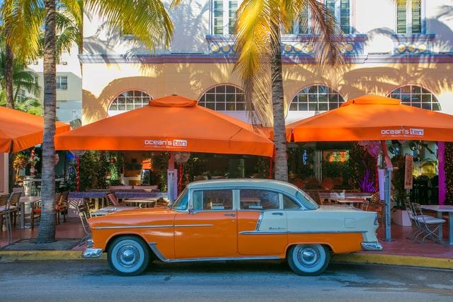 1950's orange automobile parked on street in Miami.
